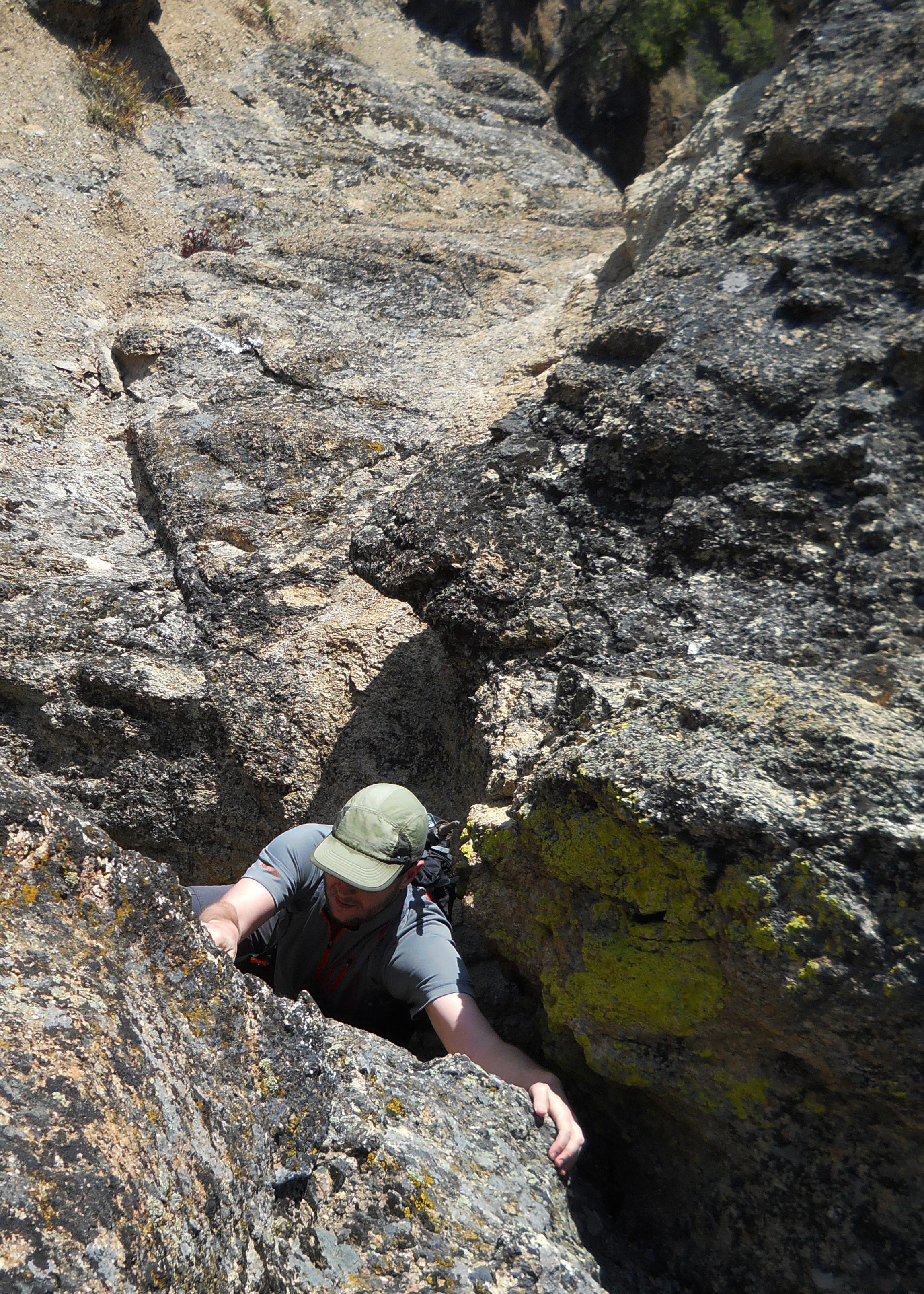 Jason climbing the final bulge. The feet below. Pat McGrane Photo