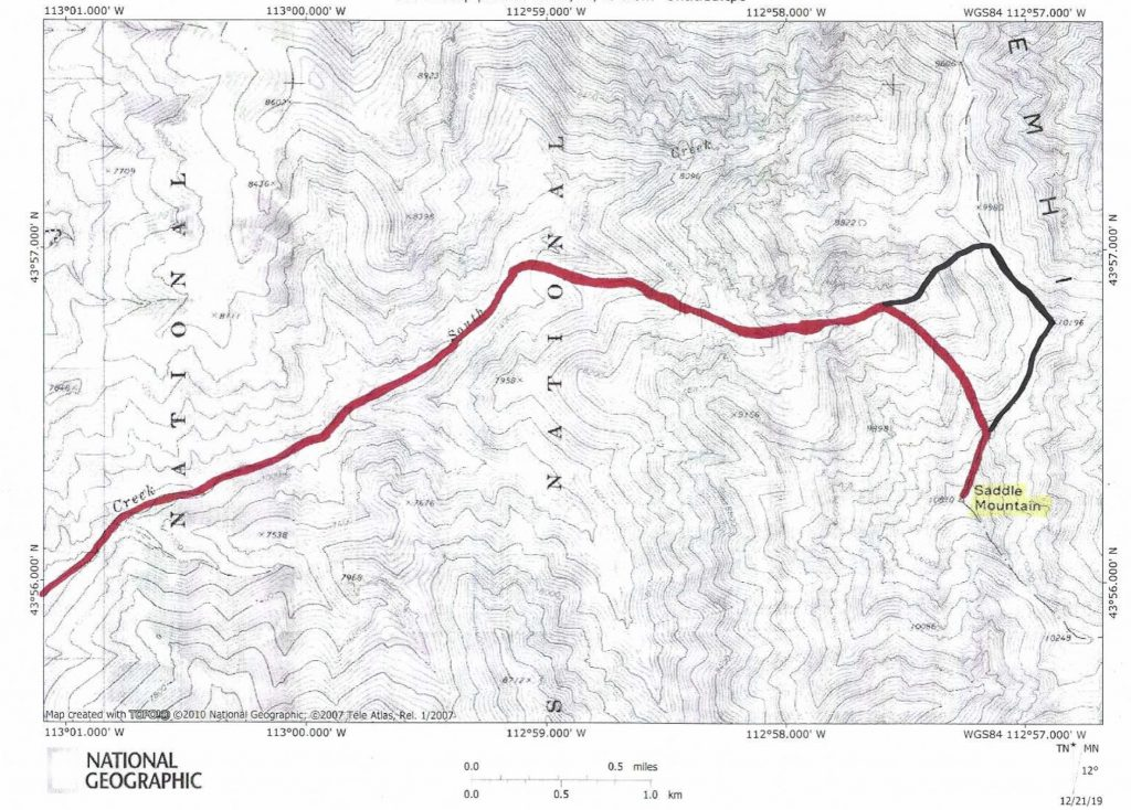 The ascent route (red) and the descent route (black).