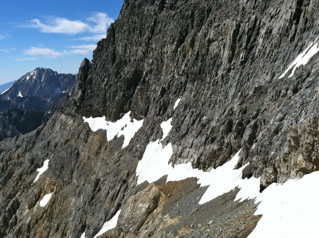 The Dirty Traverse ledge leading out to the East Ridge from the center of the face. Photo - Wes Collins