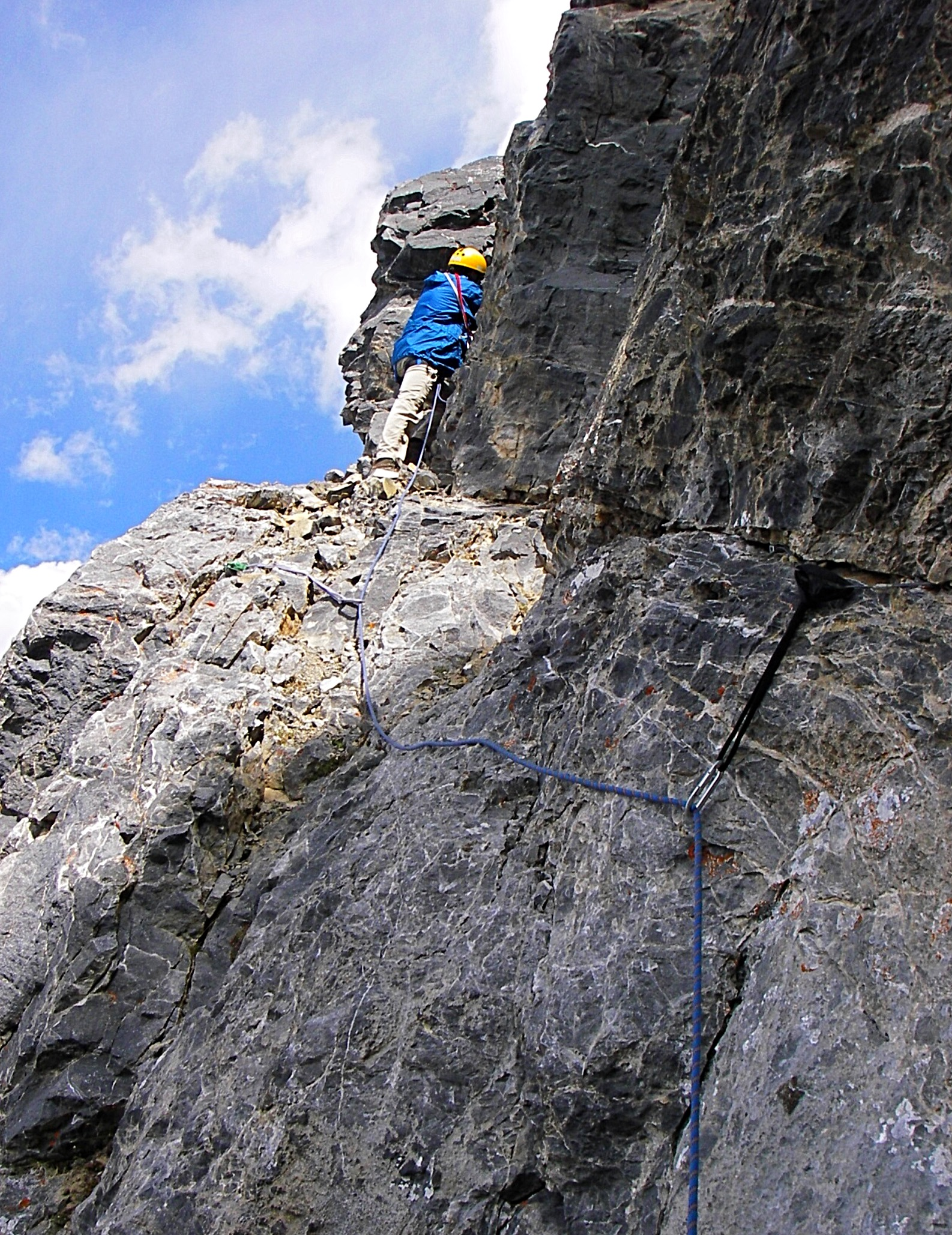 Move left on the ledge a short way until you reach the bottom of a narrow gully. Climb up this to the summit. The angle eases off and the rock quality deteriorates. The pitch was about ½ a rope length (60-m rope). Judi Steciak Photo
