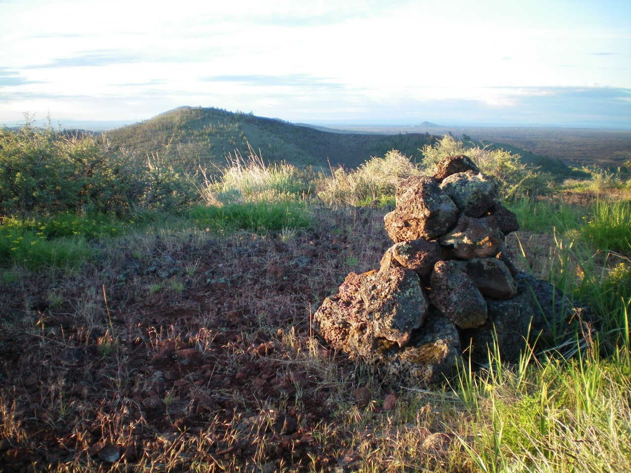 The summit cairn atop Grassy Cone, looking south. Silent Cone is in the distance. Livingston Douglas Photo