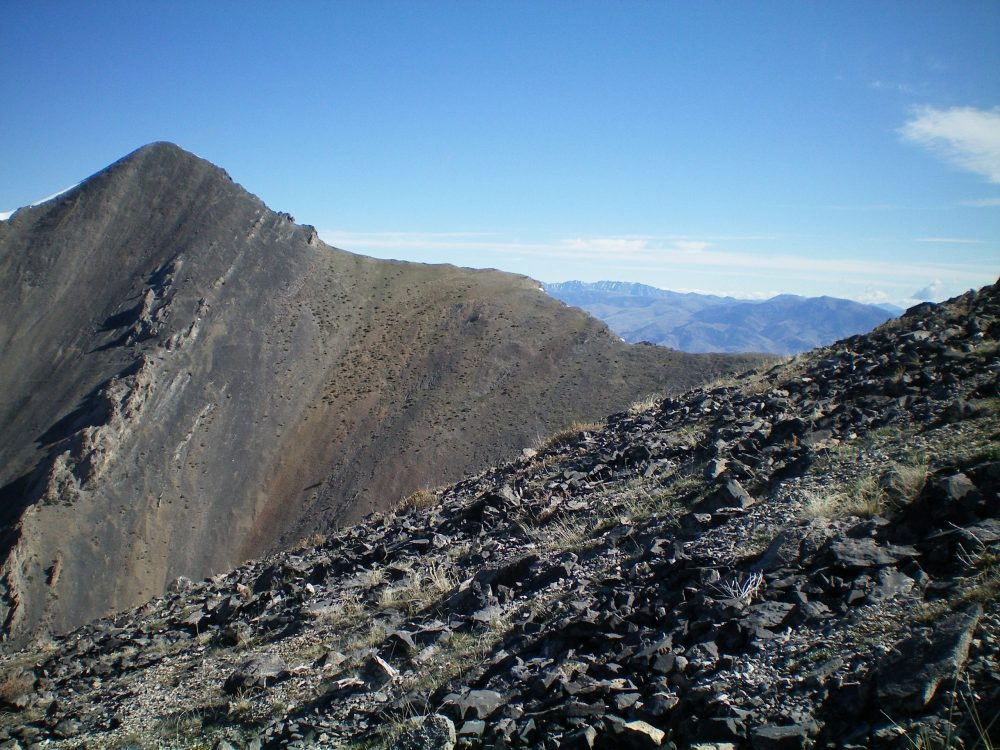 The rocky terrain of the West Ridge of Mount Hoopes (foreground) with Mount Tyler and its Southeast Ridge in the background. Livingston Douglas Photo