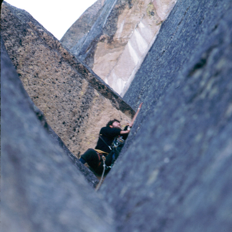Gordon at the top of the jam-crack lead on the second pitch of the Open Book. The crack ends under the overhang and climbers are forced out right onto thin holds. Mark Sheehan Photo