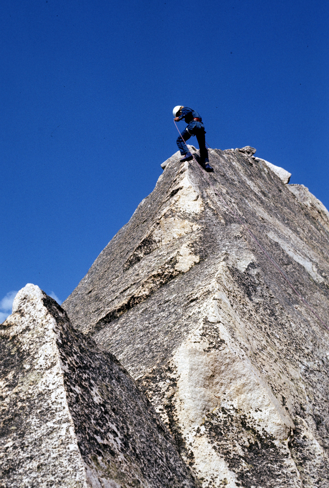 David Thomas rappelling off the summit of Warbonnet, 1972.