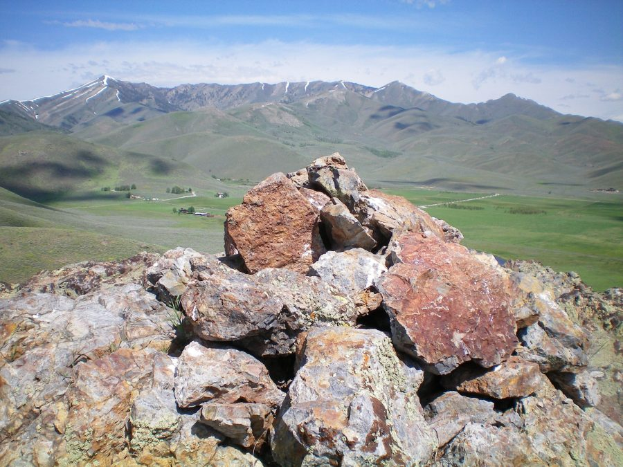 The summit cairn atop Rocky Butte, looking NW across the ranch land of Gilman Flat. Livingston Douglas
