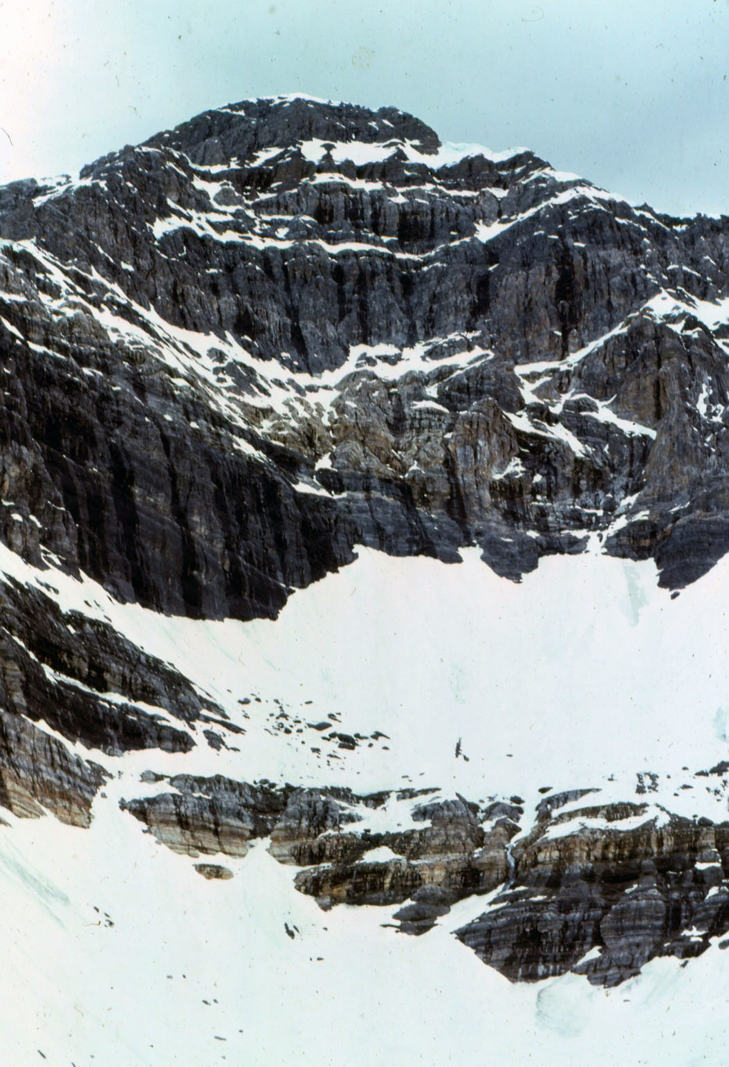 If you look closely, you can see the old blue ice showing in places. Under the snow, the ice appeared to be over 50-feet thick. The East Face of Mount Borah – June 1974. Photo by Bob Boyles