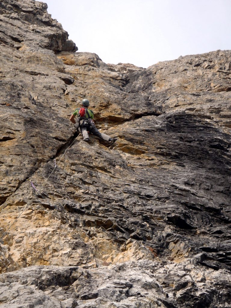 Cory on Pitch 1, just about to leave the right angling crack for the vertical seam. Photo - Kevin Hansen