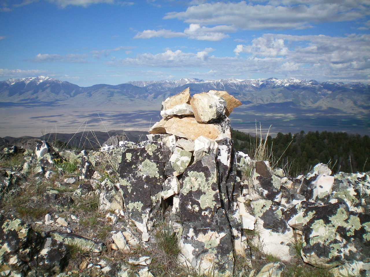 The summit cairn atop the rocky high point that is the summit of Peak 8923. Livingston Douglas Photo