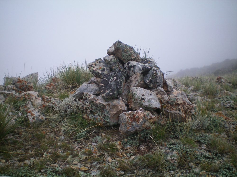 The summit cairn atop Peak 6990. Livingston Douglas Photo