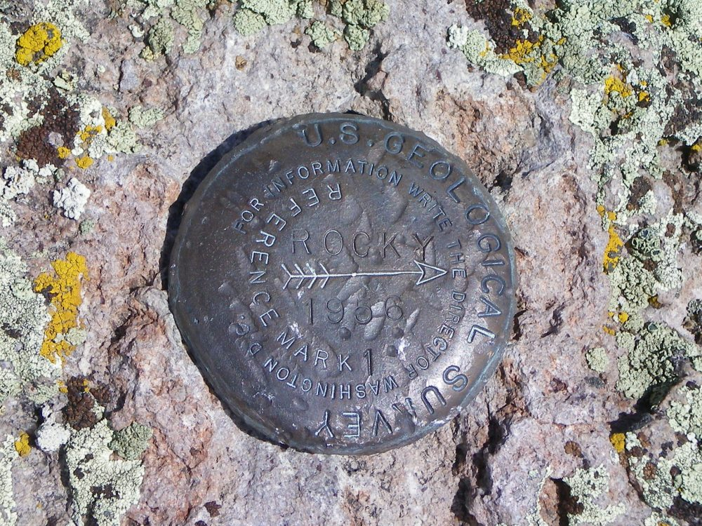 """The """"Rocky"""" USGS Benchmark atop Wedge Butte. 2 other BMs are nearby. Livingston Douglas Photo"""