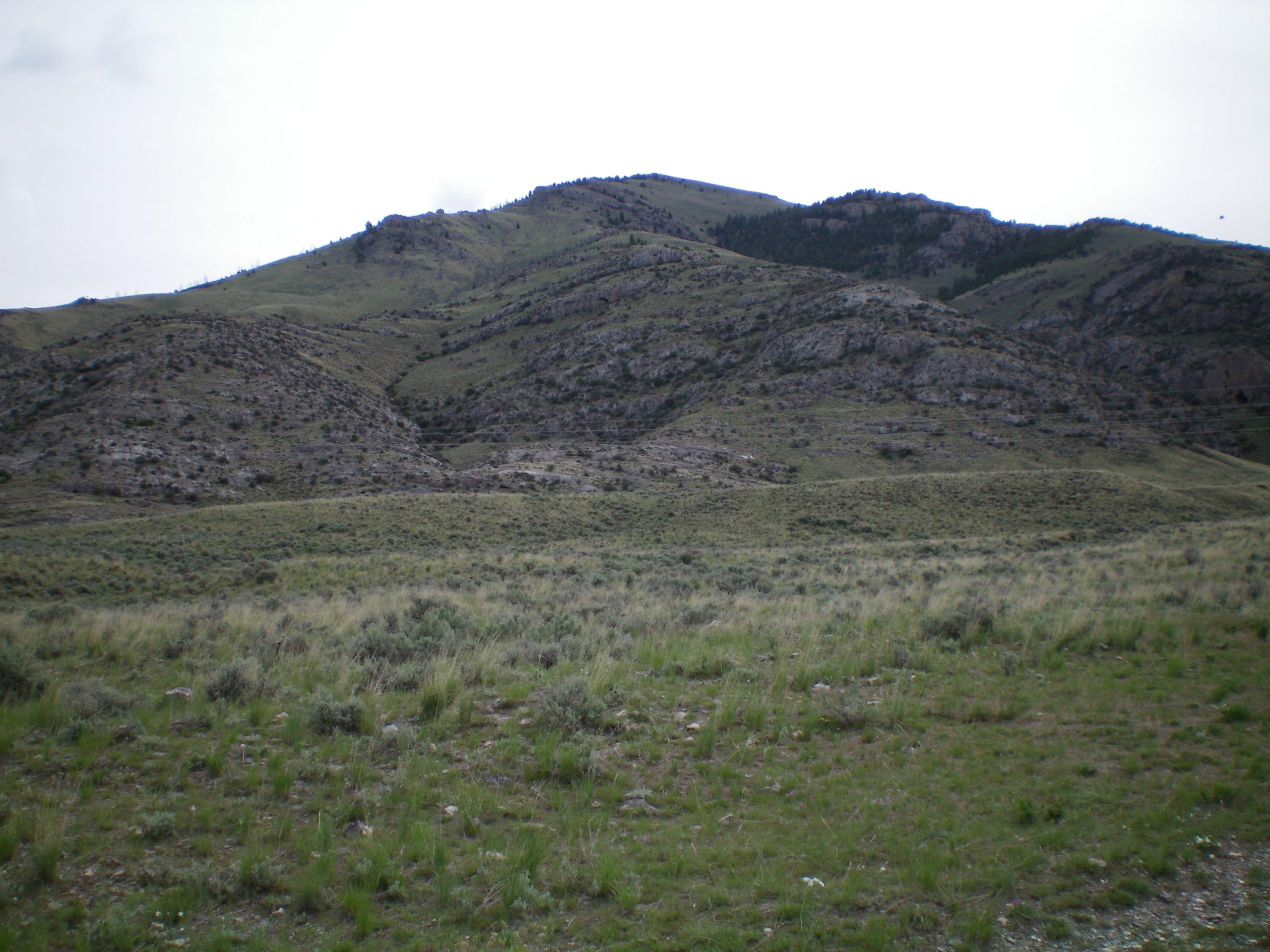View of the West Ridge Route (the ridge in the middle) from the parking spot at the cattle fence/gate. Notice how rocky and rugged the initial section of the West Ridge is. Livingston Douglas Photo
