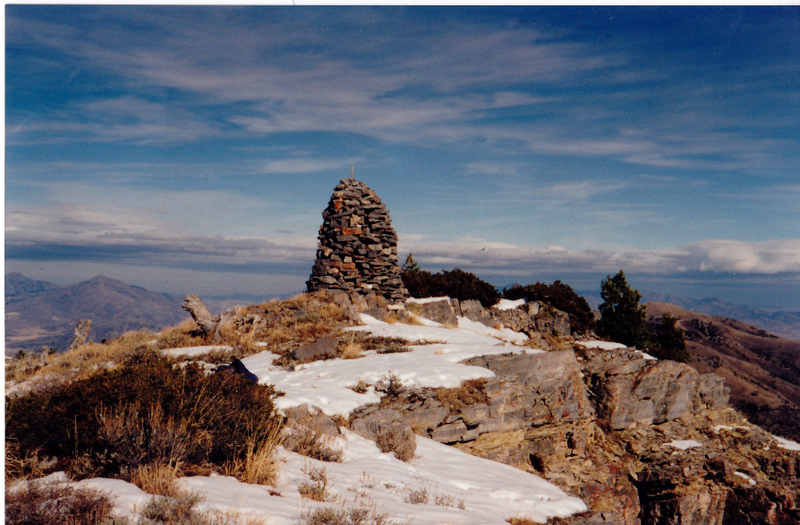 Elkhorn Mountain's summit cairn. The view is to the north, Old Tom Muntain is seen to the left, on November 18, 1995. This Elkhorn Mountain is on the Columbia/Great Basin watershed divide. Rick Baugher Photo and commentary.