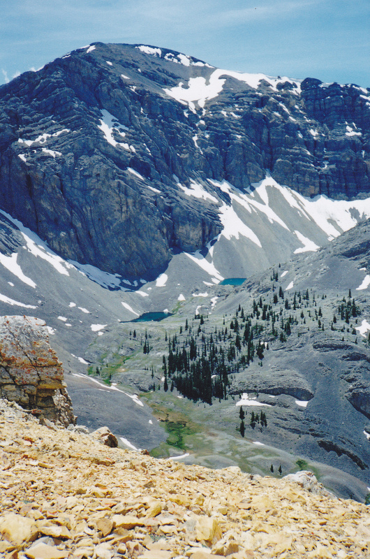 This shot was taken from the south end of Massacre Mountain at around the 10,800 foot level looking across Hell Roaring Canyon and Shadow Lakes to the north face of Clyde Ross Peak. Rick Baugher Photo 7-13-97