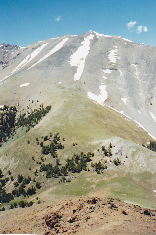 Apex Peak. The photo was taken from East Burnt Peak, 10149' where an ancient cairn was found, East Burnt Peak is the second highest volcanic summit in the Lost River Range. Photo and Commentary by Rick Baugher.