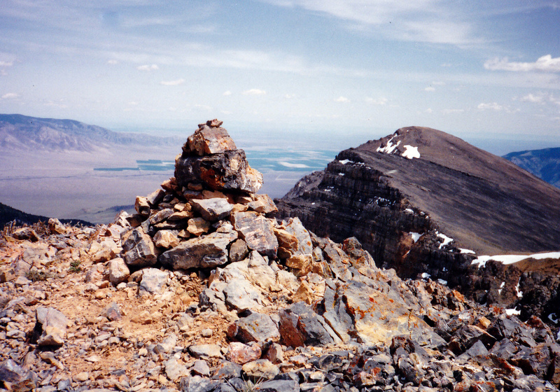 "The summit cairn on Ramshorn Peak looking south to its lower summit know as ""The Sweater."""