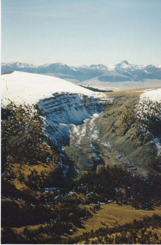A rather uncommon sight in the southern Beaverhead Range is this evidence of classic U-shaped glaciation found on the north side of Eidelman Peak. This shot was taken from Peak 10404 (Dianes Mountain) on the Idaho/Montana Continental Divide. Rick Baugher Photo and Commentary.