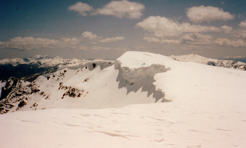 The summit of Mount Carpenter on June 1, 1996. In the background are Montana's Lima Peaks.