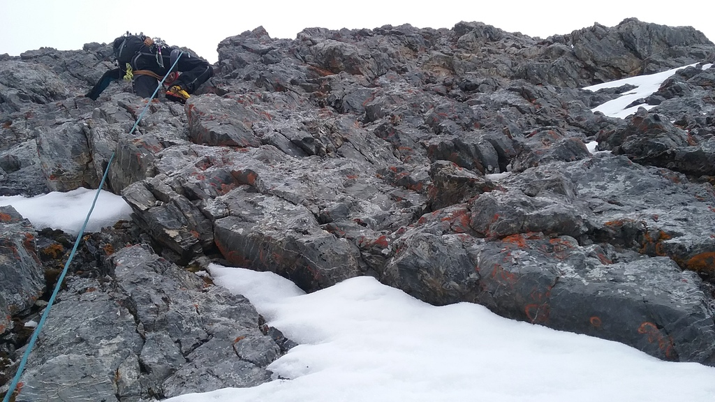 The brave Sean Muldoon leading a tricky pitch on loose rock well above the protection of the belay. Kevin Hansen photo