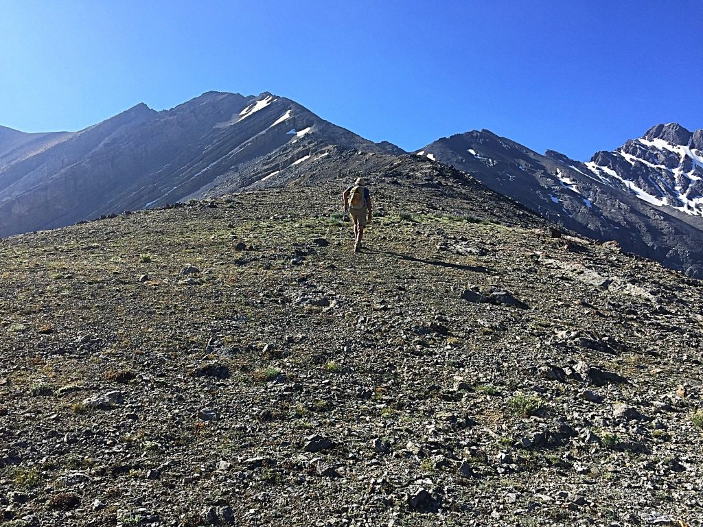 The route climbs steeply out of the pass and then crosses a long, less steep section between 10,000 and 11,000 feet.