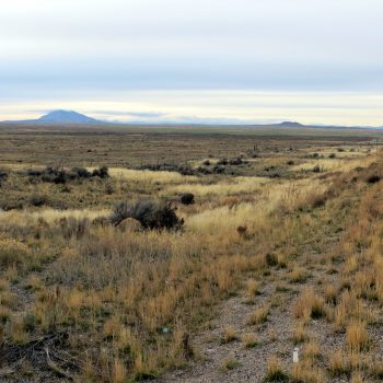 Table Legs Butte (right) and Big Southern Butte (left) from the shoulder of Idaho Highway 26.