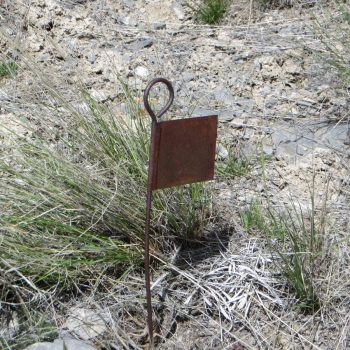 A summit-ish marker on Peak 6934. Steve Mandella photo.