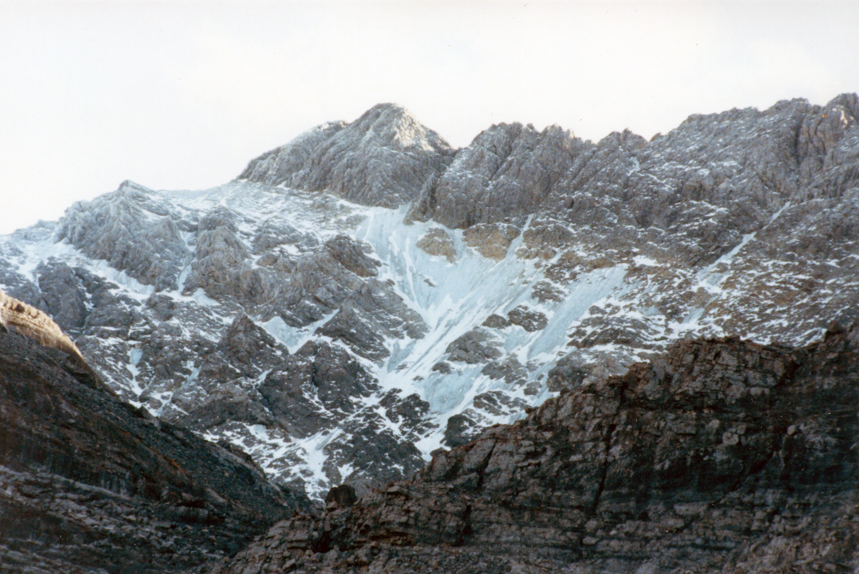 The North Face of Mt Borah Sept, 1990 – Photo by Curt Olson We were in shock when we saw this. The glacier and lower ice fields were almost gone. This was the last photo we got of the old blue ice that was estimated to be over 500 years old or more.