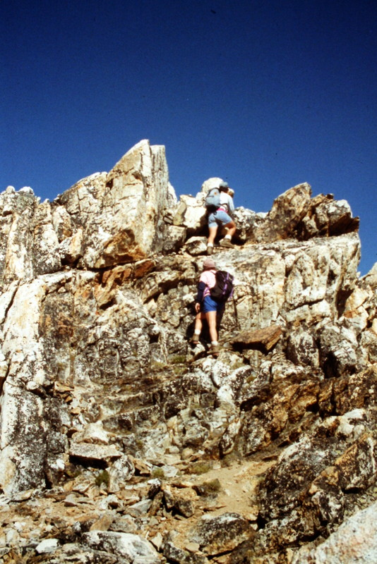 The last few feet to the summit on the standard route involve a bit of Class 3 climbing,.