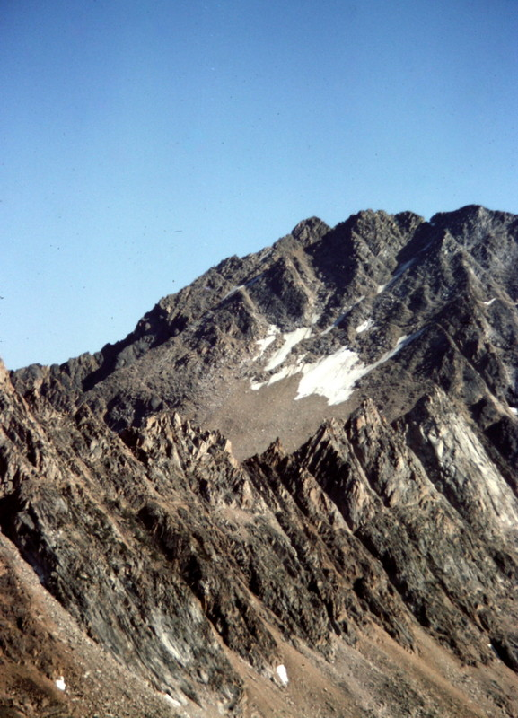 Castle Peak with the Serrate Ridge in the foreground.