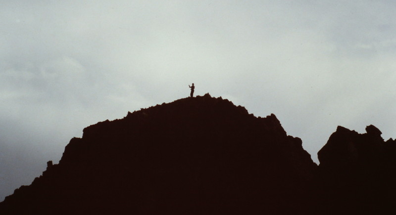 A lone climber on the summit.
