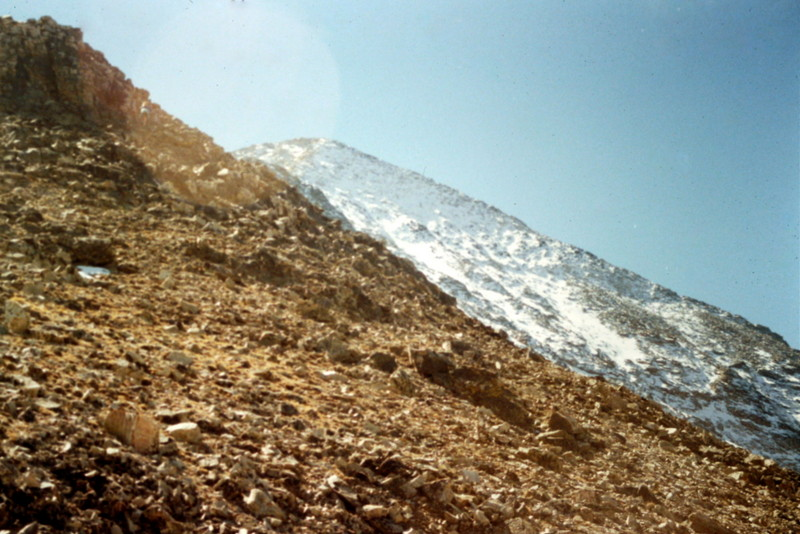 This photo is looking up into the sun toward the summit from midway on the Northeast Ridge Route.