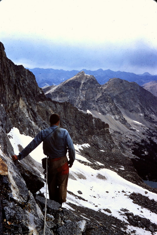 Francis Willmarth surveying an approaching thunderstorm during a 1954 attempt on the north face of Goat Mountain. Evilio Echevarria Photo