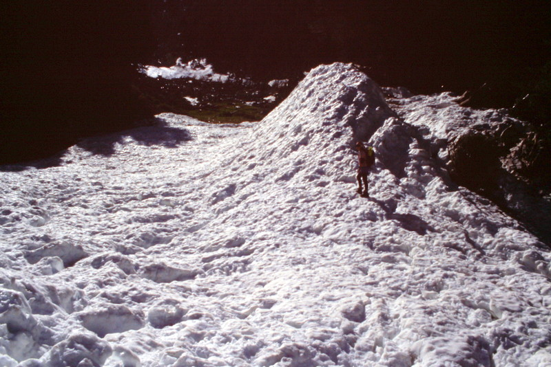When I climbed the peak on June 24th, 1995, we found the remnants of a huge avalanche that had swept the face. As you climb up the west face you will see that it provides a tremendous area for snow to accumulate.