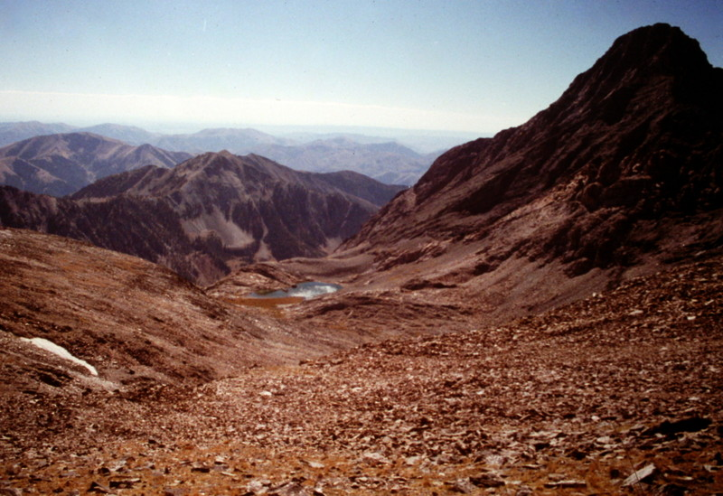 The standard route climbs into this high basin which is a sea of talus and broken rock. Cobb Peak is on the right. Big Basin Peak is out of the photo to the left and Old Hyndman is off the photo to the right.