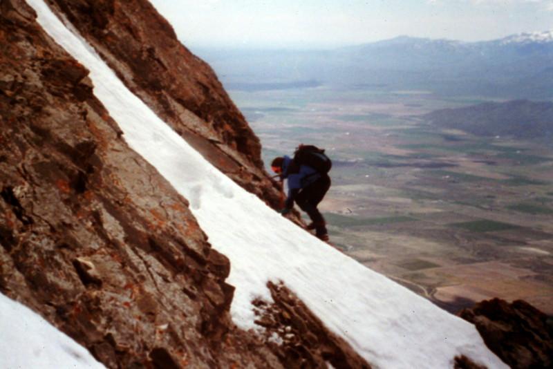 Dana Hansen climbing a Class 3 cliff on the peak's west face.