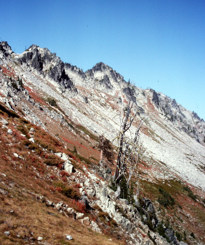 The route starts out on easy but steep terrain before encountering route finding problems on the ridge above.