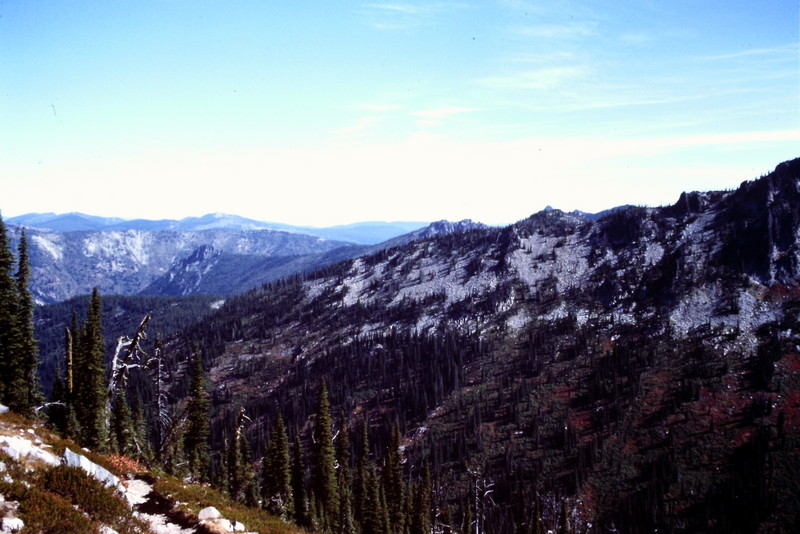 The deep canyons are filled with thick forests.