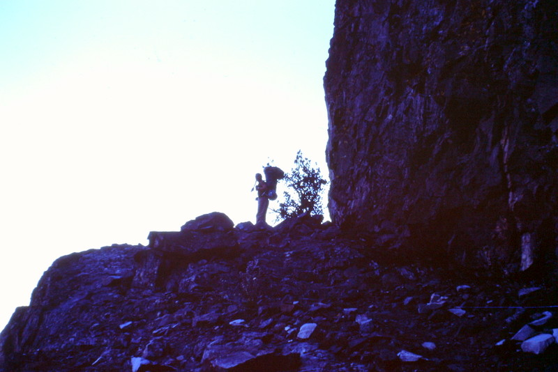 A hiker on the crosscountry route to Sheep Lake on the ledges above and north of the lake.