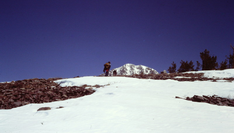 The summit comes into view only after a long trudge up the west ridge.