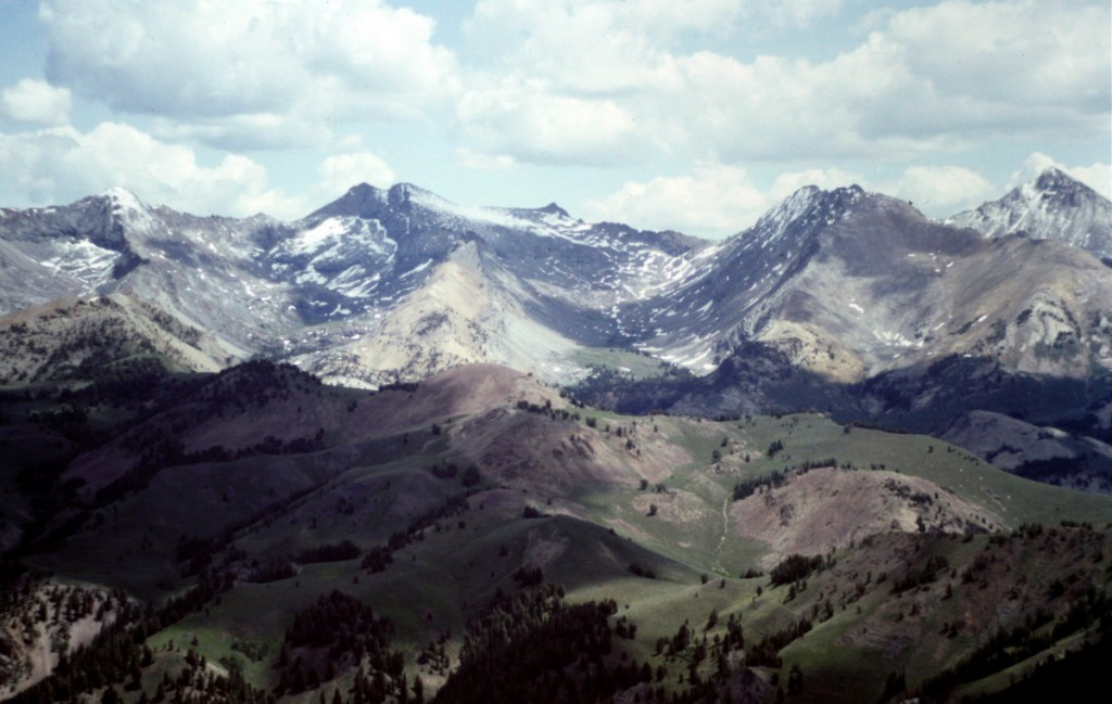 The Pioneer crest viewed from Johnstone Peak. Goat Mountain is the two summitted peak on right horizon. Handwerk is below it to the left. Duncan Ridge is next and then Hyndman Peak.