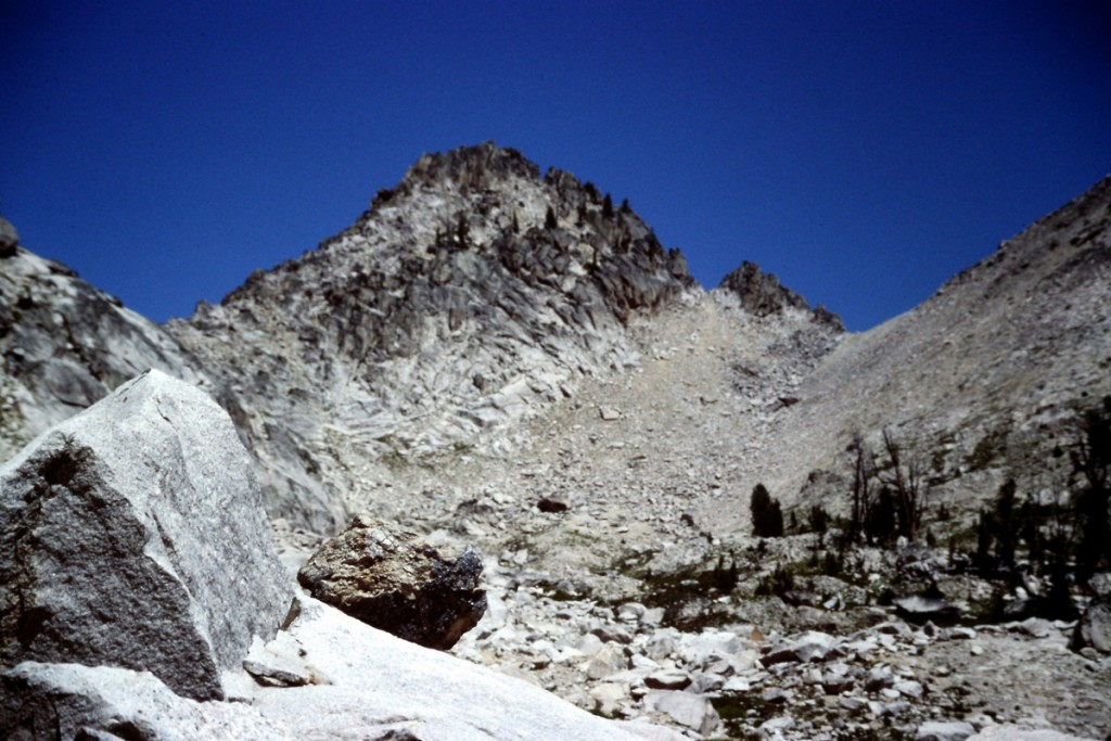 Alpen Peak's west summit. The pass on the left leads into the basin on the south side of Warbonnett Peak. The Pazss on the right leads to Alpine Lake.