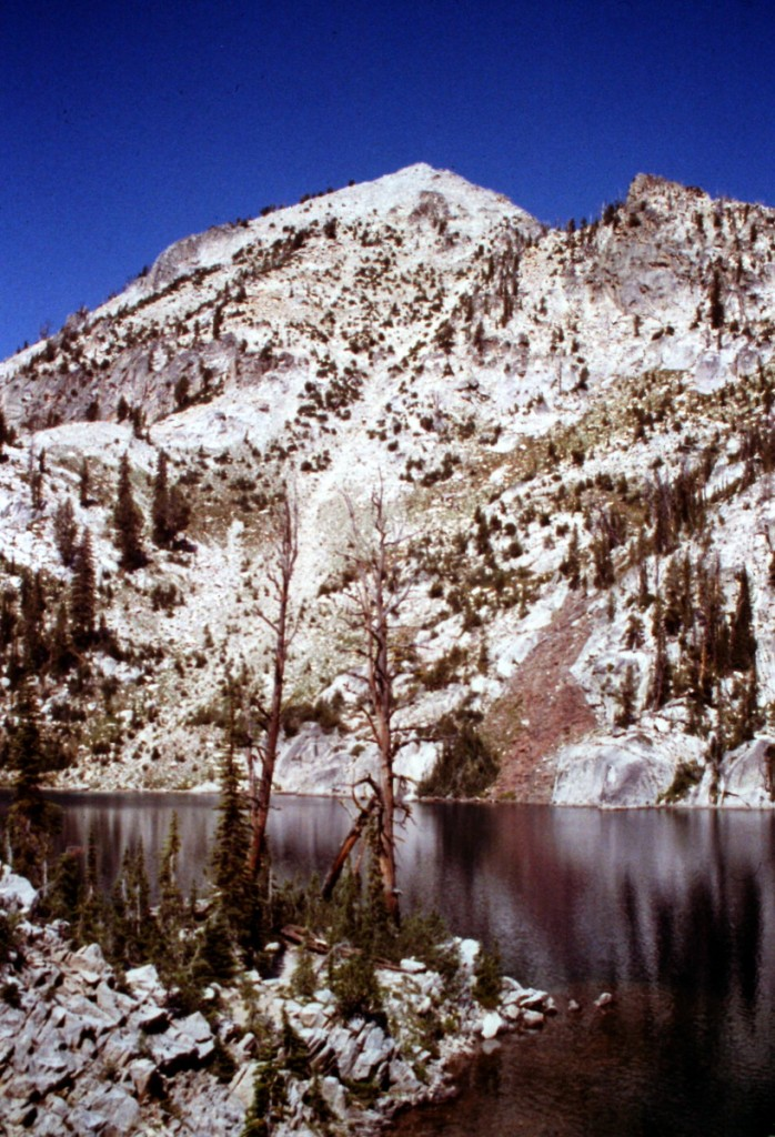 The east face of Mount Everly rising up above Everly Lake. The standard route climbs up this face.