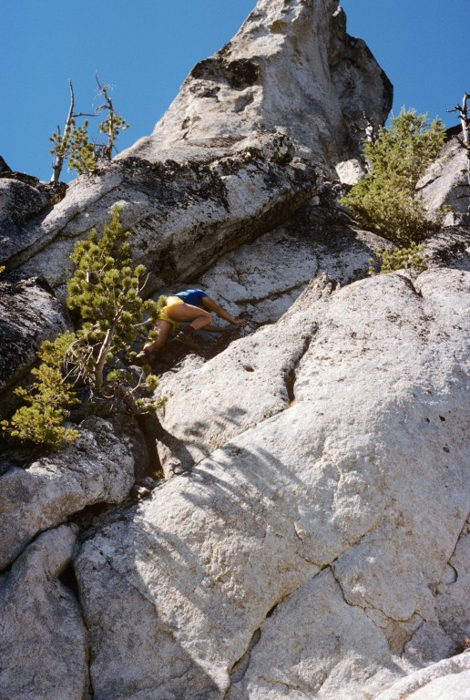 A climber moving up the Class 4 route to the high point of Needles Peak is located one third of the way up the route.