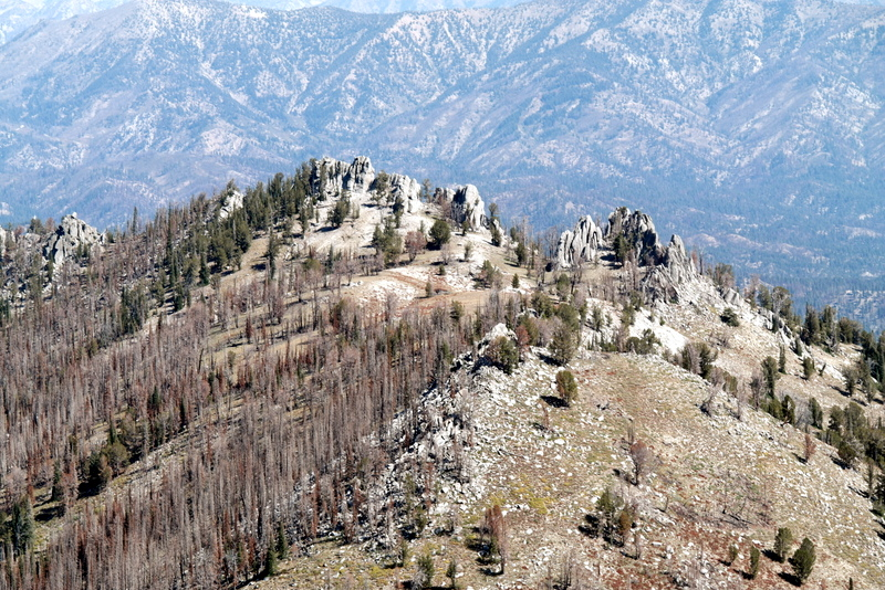 Peak 8889, which is several hundred feet shorter than its neighbors, is interesting because it is covered by many granite towers of varying sizes.