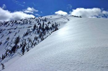 The Crescent: a large semi-circular snow heap visible on Snow Peak until mid-summer. Scot Kelchner photo.