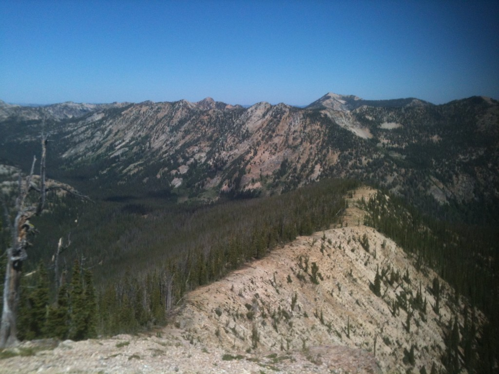 This shot looks back down the sunnit ridge and west to Profile Peak and numerous other peaks in the area.