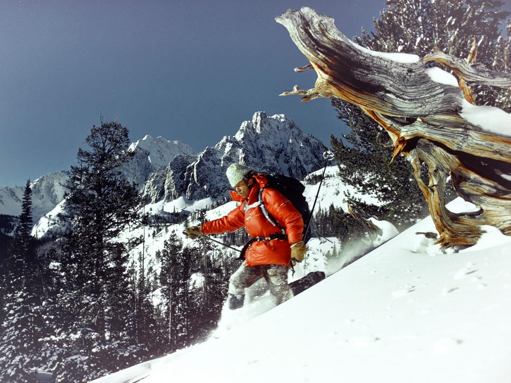 Joe Leonard skiing below Castle Peak in 1972. A photo taken by a National Geographic photographer. Joe Leonard Collection