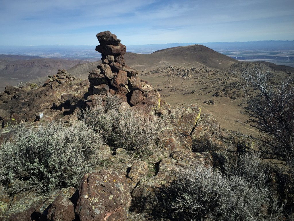There are four large cairns on the summit ridge. This one is on the high point. There is a register with a new notebook as of March 2016.