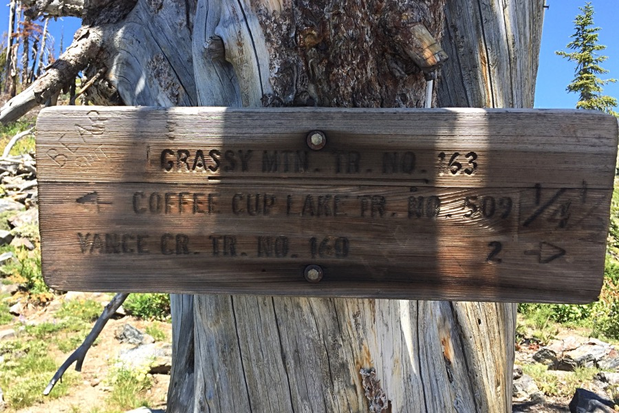 The crest of the Grass Mountains is reached via a good trail. This sign was found at the pass in 2016. Point 8048 is uphill behind the sign.