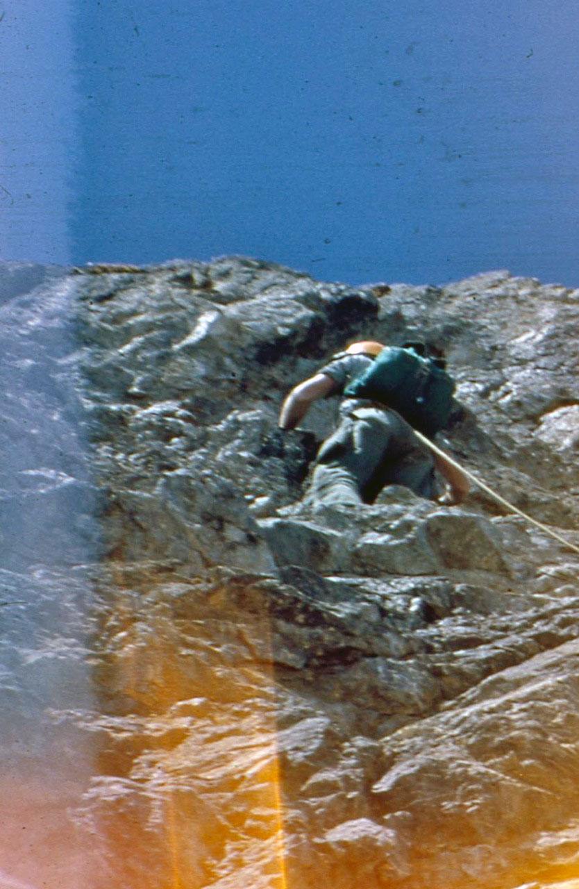 Lyman Dye climbing on the East Face of Mount Borah. Photo - Wayne Boyer. Lyman Dye Collection