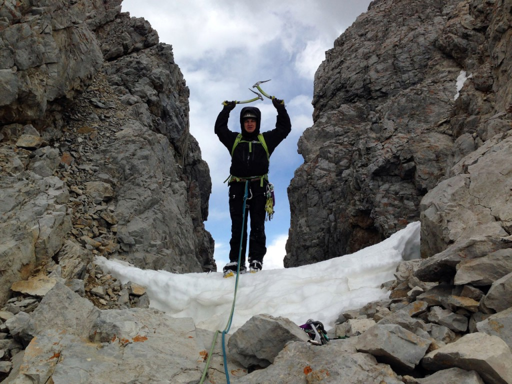 Kevin stands atop the couloir. Photo - Cory Harelson